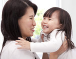 Close-up of asian little girl and  her mother