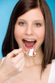 Healthy lifestyle - woman eat cereal yogurt