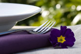 place setting and purple flower