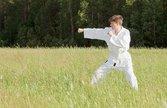 Man in kimono engaged oriental combat sports