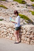 young attractive woman with hat and a map