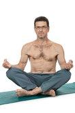 adult healthy man making sports gymnastics isolated
