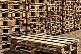 Wooden transport pallets in stacks.