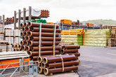 different pipes for industry stacked in a warehouse