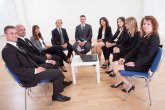 Successful Happy Business People Sitting On Chairs