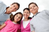 Portrait of young family looking happy