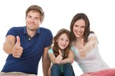 Happy Family Showing Thumbs Up Together