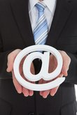 Businessman Holding Internet Symbol
