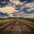 Conceptual Image of Road With the Word Achieve