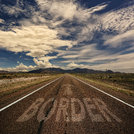 Conceptual Image of Road With the Word Border
