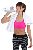 fitness young woman drinking water sports workouts