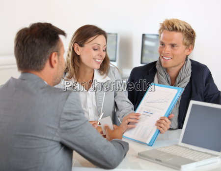 business partners presenting business plan to investor stock photos