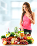 Young woman with assorted organic food products