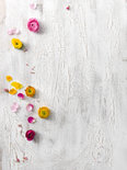 white wood background with flowers