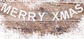 Merry Christmas sign on wooden background with copy space