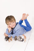 Boy with toy animals