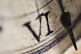 time:closeup of the roman number of a clock