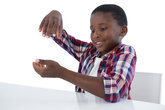 Boy pretending to work on an invisible object