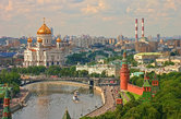 Panoramic view on Moscow Red Square Kremlin towers, Christ the Saviour Cathedral, Moscow river, bridge. Aerial Moscow panorama of old and modern Russian architecture. Famous sightseeing tours places