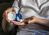 Woman with overweight takes medication, conceptual image