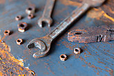 Old rusty wrench over battered metal table rough style. Wrenches top view for construction, industrial, electrician concept design