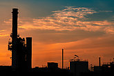 Gas turbine electrical power plant. Energy for support factory in industrial estate. Natural gas tank. Small gas power plant. Power plant using natural gas for fuel. Green energy. Dramatic sunset sky.