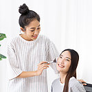 Roommates have fun learning to make-up for asian friends